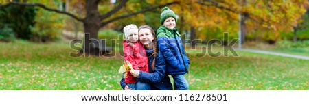 Panorama of mother and kids outdoors at beautiful autumn park
