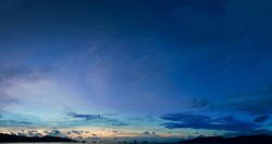 Panorama of night sky clouds above the tropical sea harbor