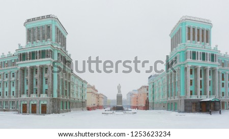 Panorama of October Square in the Norilsk city. Beautiful buildings in the architectural style of the Soviet neo-classicism. In the center is a monument to Vladimir Lenin. Krasnoyarsk region, Russia.