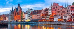 Panorama of Old Town of Gdansk, Dlugie Pobrzeze and Motlawa River at night, Poland