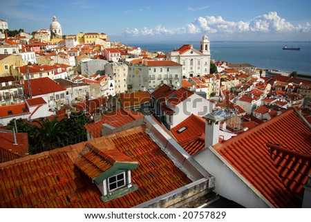 Panorama of old traditional city of Lisbon with red roofs and view of river Tagus