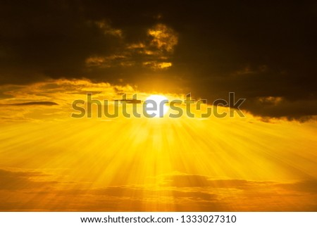 Panorama of orange sky and stormy clouds with the yellow sun shining at Golden Hour time background sunrise or sunset acene