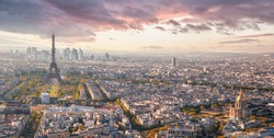 Panorama of Paris with Eiffel Tower against sunset in France