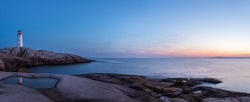 Panorama of Peggys Cove's Lighthouse after Sunset (Nova Scotia, Canada)