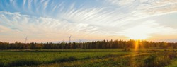 Panorama of PEI rural scene at fall with windmills on the background  (North Cape Coastal Drive, Prince Edward Island, Canada)