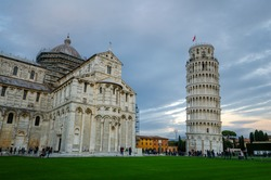 Panorama of Pisa Cathedral (Duomo di Pisa) with Leaning Tower (Torre di Pisa) and Baptistery of St. John (Battistero di Pisa) in Tuscany, Italy at sunset. One of the main landmark in Italy.