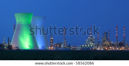 Panorama of power station at night under blue sky  - Oil Refineries - stock photo