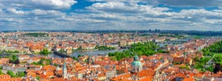 Panorama of Prague city. Aerial panoramic view of Prague Old Town historical centre, Charles Bridge Karluv Most across Vltava river and Mala Strana Town with red tiled roof buildings, Czech Republic