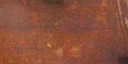 Panorama of rusty metal wall, old sheet of iron covered with rust and corrosion paint. Oxidized iron panel. Texture or background.