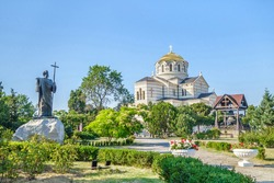 Panorama of Saint Vladimir Cathedral and its belfry. Statue of Andrew the Apostle in the garden. Shot in Sevastopol, Crimea