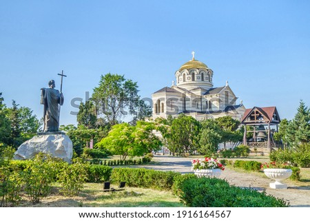Panorama of Saint Vladimir Cathedral and its belfry. Statue of Andrew the Apostle in the garden. Shot in Sevastopol, Crimea Сток-фото ©