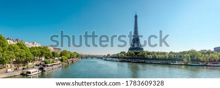 Panorama of Seine in Paris and Eiffel tower in beautiful summer day in Paris, France
