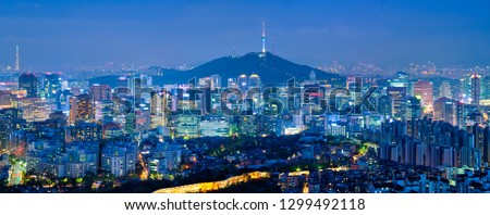 Panorama of Seoul downtown cityscape illuminated with lights and Namsan Seoul Tower in the evening view from Inwang mountain. Seoul, South Korea.