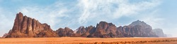Panorama of Seven Pillars of Wisdom rock formation as seen from visitor centre in Wadi Rum protected desert, Jordan