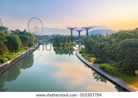 Panorama of Singapore gardens with pond at sunrise stock photo