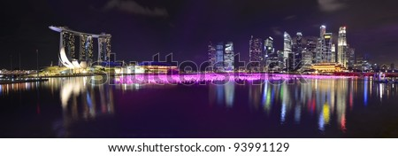 Panorama of Singapore skyline and river at night