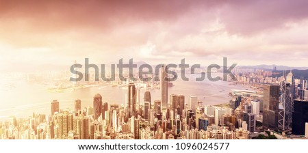 panorama of skyscrapers and a river around the city under sunshine