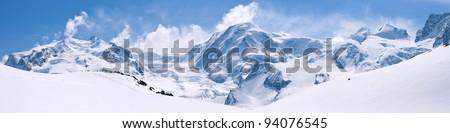 Panorama of Snow Mountain Range Landscape with Blue Sky at Matterhorn Peak Alps Region Switzerland #94076545