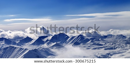 Panorama of snow plateau and sunlight sky in evening. Caucasus Mountains, Georgia. View from ski resort Gudauri.