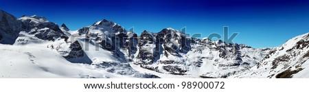 Panorama of snowy mountain ridges with blue sky in Diavolezza Switzerland