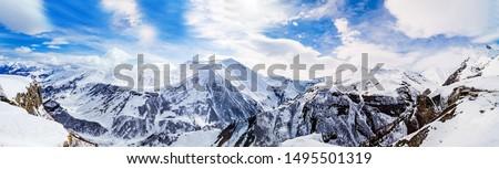 Panorama of snowy mountains. Caucasus mountains, Georgia, view from Gudauri ski resort.
