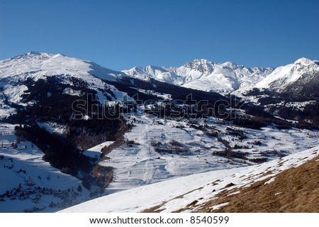 panorama of snowy mountains in the sunny swiss alps around christmas time