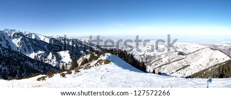 Panorama of Snowy winter in mountain forest. Amazing place for activity extreme sport and climbing in Almaty, Kazakhstan, Asia