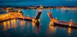 Panorama of St. Petersburg in the white night. Divorced Palace bridge. The bridge over the Neva divorced. Bridges Of St. Petersburg. Rivers Of St. Petersburg. Vasilievsky island. Urban lighting.Russia