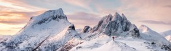 Panorama of Steep peak mountains with covered snow and mountaineer man backpacker stand alone