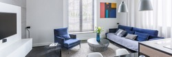 Panorama of stylish design living room with tv and blue furniture set