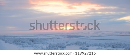 Panorama of sunset in the Arctic Circle, tundra of the Yamal Peninsula, Russia