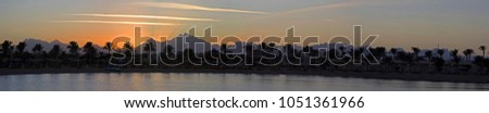 Panorama of sunset near Hurghada #1051361966