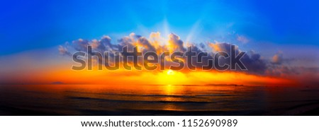 panorama of sunset with lighted clouds on the sea #1152690989