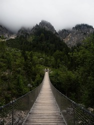 Panorama of suspension bridge Klausbachtal Berchtesgaden National Park near Ramsau Bavaria Germany alps mountains