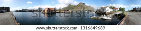 Panorama of Svolvaer city with shed; storehouse, harbor bay and bridge on Lofoten archipelago, Nordland, Norway
