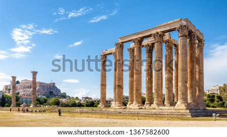 Panorama of Temple of Olympian Zeus, Athens, Greece. It is a great landmark of Athens. Huge Ancient Greek ruins overlooking Acropolis of Athens. People visit the remains of the antique Athens city.