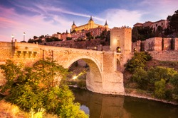 Panorama of the alcazar above the medieval San Martin bridge - Toledo, Spain