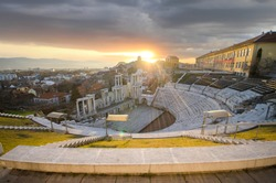 Panorama of the Amphitheatre in Plovdiv, Bulgaria at sunset - european capital of culture 2019. Ancient roman theater a venue for dramatic and musical performances. One of the oldest cities in world