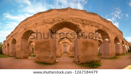 Panorama of The Ancient ruined arches of the massive Royal Stables and Granaries of Moulay Ismail in the Imperial City of Meknes, Morocco near Fes. Miknasa