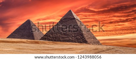 Panorama of the area with the great pyramids of Giza at amazing sunset, Egypt