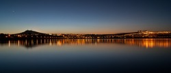 Panorama of the city of Leon, Guanajuato. Gto,. Mexico at Parque Metropolitano at sunset with the reflection of the skyline and the mountains
