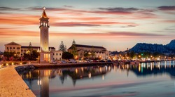 Panorama of the cityscape and harbour of Zakynthos town during dusk just after a summer sunset, Ionian Sea, Greece