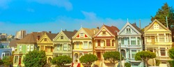 Panorama of the colorful victorian houses of San Francisco. Urban tourist attraction of California, United States of America.
