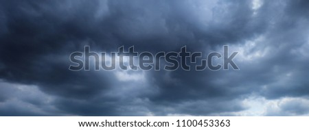 Panorama of the dark clouds make the sky in black. Pattern of the clouds can not predict this is tornado, Hurricane or thunderstorm. Sometimes heavy clouds but no rain.