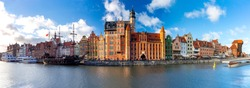 Panorama of the facades of old medieval houses on the promenade in Gdansk. Poland.