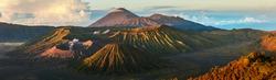 Panorama of the group of volcanoes in the National Park of Java island, Indonesia. Bromo (smoking), Batok, Semeru volcanoes