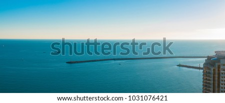 Stock Photo Panorama of the harbor with a lighthouse and boats