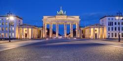 Panorama of the illuminated Brandenburg Gate in Berlin at dawn