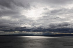 Panorama of the lake before the rain. Thunderclouds over the lake.