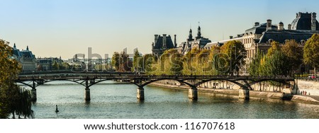 Panorama of the Louvre museum and the bridge of arts in autumn